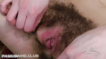 Liza James is dirty brunette who likes to spread her hairy pussy, in front of the camera