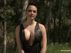 Busty woman is living in the forest and often having sex with a large group of guys